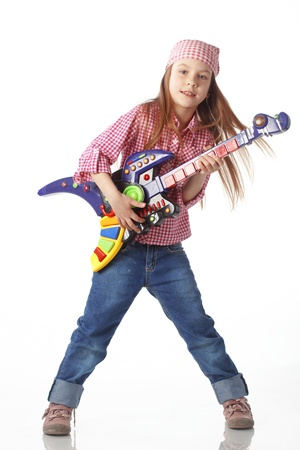 A little girl with a toy guitar isolated on white background photo