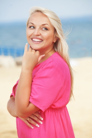 Beautiful young woman resting at the beach Stock Photo - 14384107