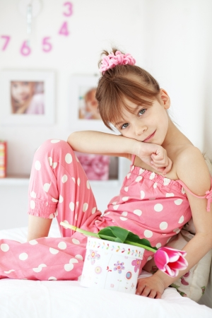 Photo of kid girl with gifts photo
