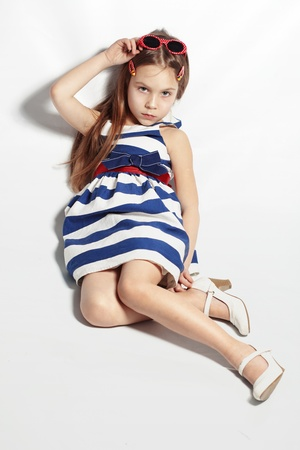 Portrait of little pin-up fashion girl sea theme Stock Photo - 14710285