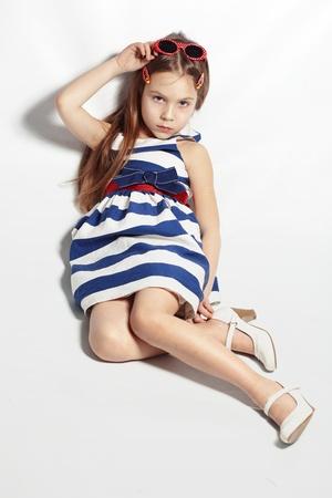 Portrait of little pin-up fashion girl sea theme Stock Photo - 14710285