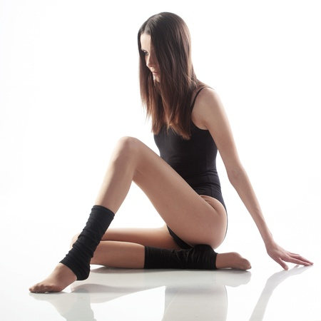 leg warmers: Portrait if slim beautiful girl studio series
