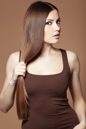 cute girl with long hair: Portrait of young beautiful woman with long glossy hair
