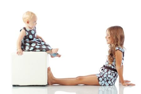 elementary age girl: Cute fashion kids isolated on white background