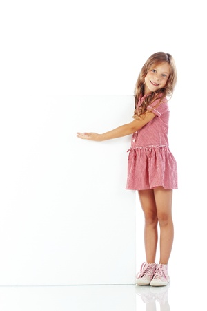 Portrait of a child girl with blank board for custom text photo