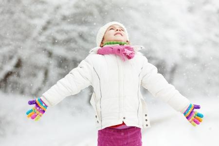 winter fun: Portrait of cute little girl in winter