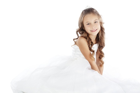 Portrait of a little princess girl wearing wedding dress isolated on white background Stock Photo - 16523178