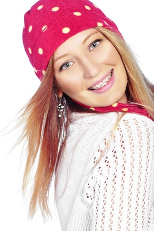 Portrait of the beautiful teenage girl wearing warm winter clothing photo