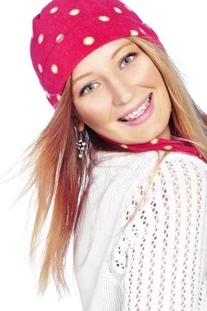 cute braces: Portrait of the beautiful teenage girl wearing warm winter clothing