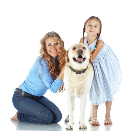 Portrait of happy woman and girl with a dog isolated on white background