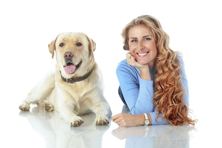 endear: Portrait of happy girl with her dog isolated on white background