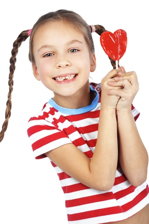 lollypop: Child holding heart shaped candy isolated studio shot Stock Photo