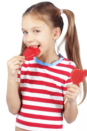 Child holding heart shaped candy isolated studio shot photo