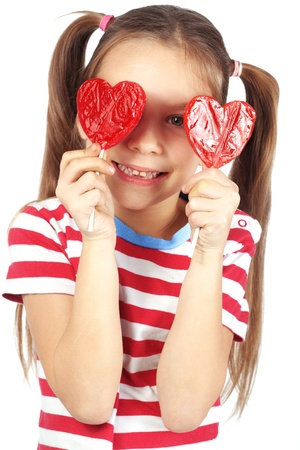 candy hearts: Child holding heart shaped candy isolated studio shot Stock Photo