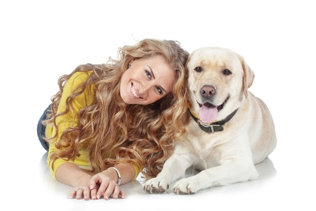 Portrait of happy girl with her dog isolated on white background Stock Photo - 17332945
