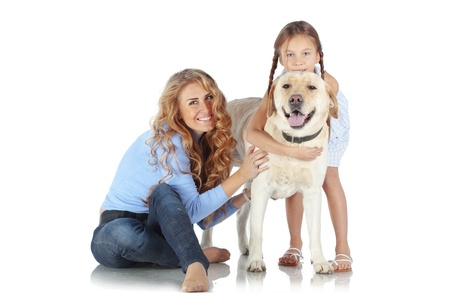 Portrait of happy woman and girl with a dog isolated on white background Stock Photo - 17332833