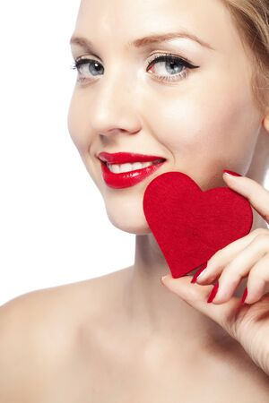 Beautiful gorgeous woman with glamour bright makeup and red heart Stock Photo - 17382153