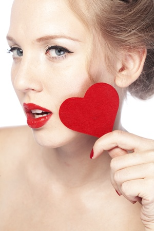 Beautiful gorgeous woman with glamour bright makeup and red heart Stock Photo - 17381221