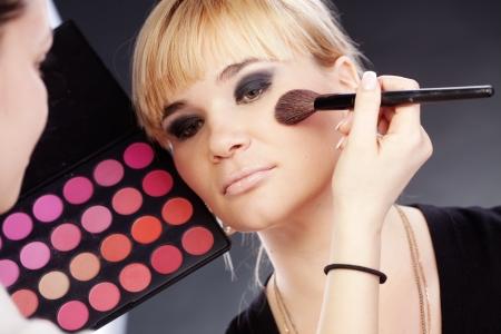Studio series of doing fashion makeup Stock Photo