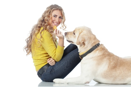 animals feeding: Portrait of happy girl with her dog isolated on white background
