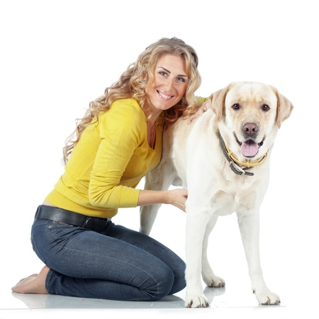 Portrait of happy girl with her dog isolated on white background Stock Photo - 17381061