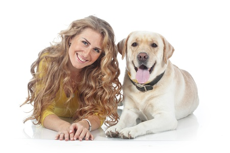 Portrait of happy girl with her dog isolated on white background Stock Photo - 17381156
