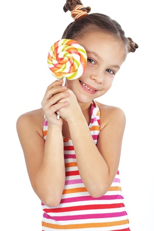 Child holding big round shaped lollipop isolated studio shot photo