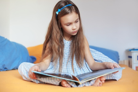 Portrait of 6 years old child reading book at home Stock Photo - 17887976