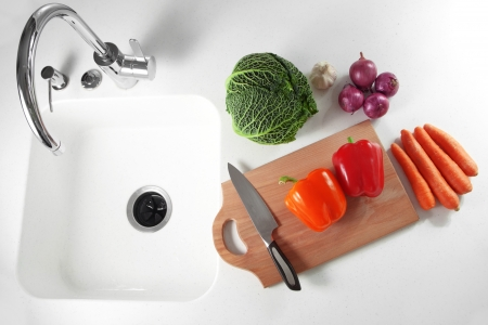 disposer: Fresh vegetables on a white kitchen table