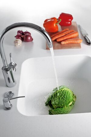 ingredients tap: Fresh vegetables on a white kitchen table