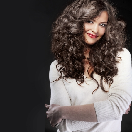 curls: Portrait of young beautiful woman with long curly volume hair