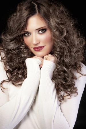 long dark hair: Portrait of young beautiful woman with long curly volume hair