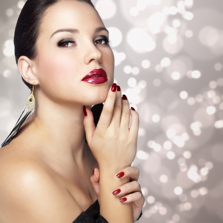 elegancy: Portrait of beautiful woman with perfect make up over party lights Stock Photo