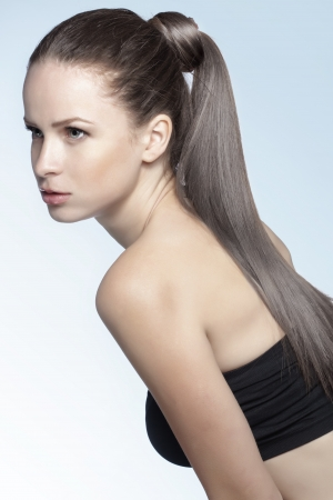 ponytail: Studio portrait of a model showing her healthy shining hair