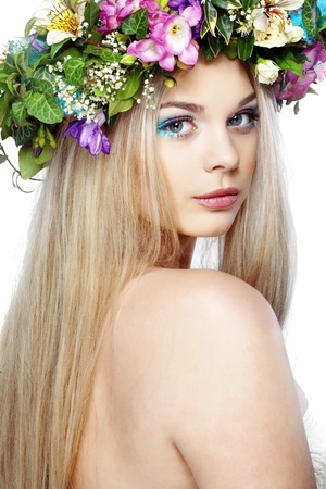 close up eyes: Closeup portrait of beautiful young girl with flower wreath on her head Stock Photo