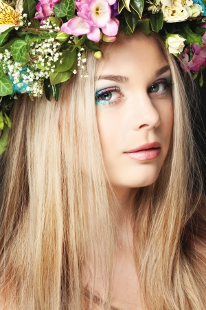 blonde  blue eyes: Closeup portrait of beautiful young girl with flower wreath on her head Stock Photo