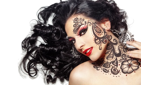 body paint: Portrait of a beautiful young girl with face art and body paint