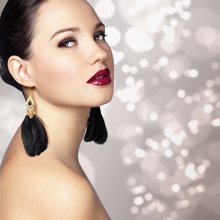 Portrait of beautiful woman with perfect make up over party lights photo