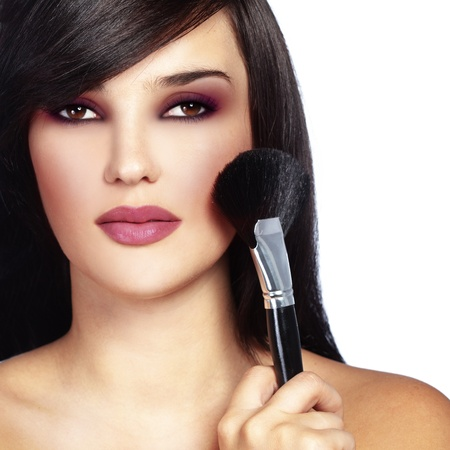 beautician: Studio series of doing fashion makeup Stock Photo