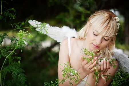 angelic: Beautiful angelic bride outdoors