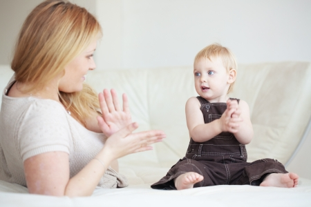 Mother playing with her toddler child at home Stock Photo - 18516991