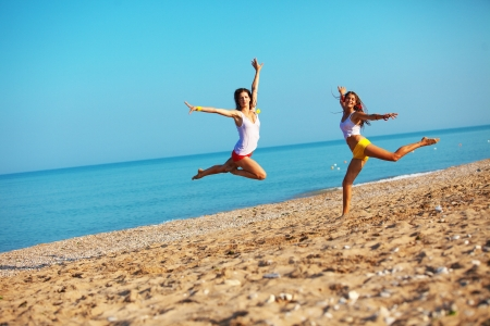 Beautiful girls having fun at beach photo