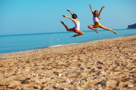 weekend activity: Beautiful girls having fun at beach Stock Photo