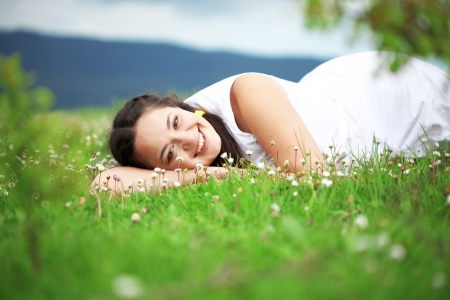 Casual outdoor portrait of young beautiful woman resting at spring nature Stock Photo