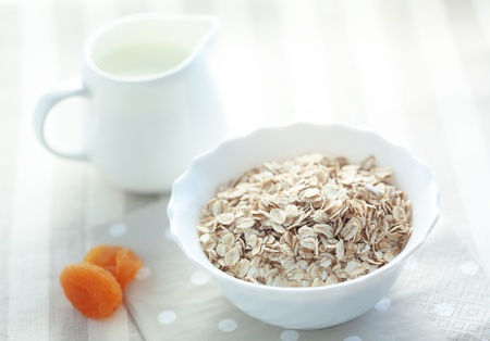 Lifestyle photo of healthy breakfast with oat-flakes and milk photo