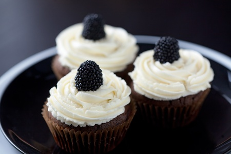 Group of cupcakes with blackberry and raspberry Stock Photo - 18818903