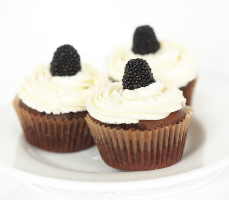 Group of cupcakes with blackberry and raspberry Stock Photo - 18818862