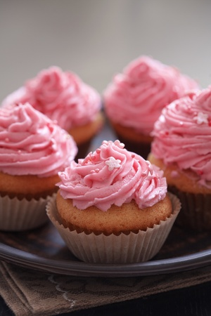 Group of pink cupcakes selective focus photo