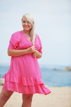 plus size woman: Beautiful young woman resting at the beach