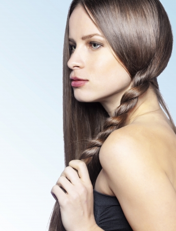long straight hair: Studio portrait of a model showing her healthy shining hair